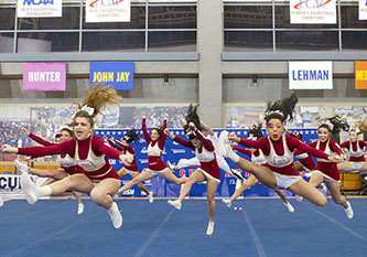 <p>Brooklyn College cheerleading team performong one of their many routines during the finals at Lehman College.</p>