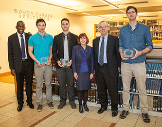 <p>Film festival winners with New York Federal Reserve President William C. Dudley, second from right, on a March 7 campus visit, and Brooklyn College President Karen L. Gould. </p>