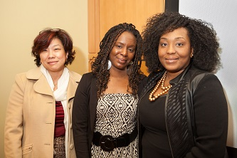 <p>Stacey Muhammad (center) is greeted by the Women's and Gender Studies Program's Endowed Postdoctoral Fellow Zinga A. Fraser (right) and Sau-Fong Au, director of the Women's Center.  </p>