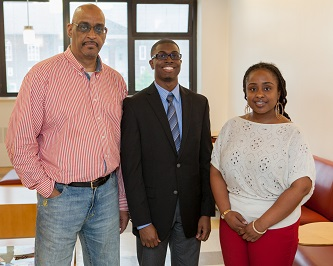 <p>Jonathan Springer '11 (center) is greeted by his valued instructors and mentors Associate Professor Haroon Kharem (left) and Adjunct Assistant Professor Trina Yearwood during a recent School of Education function.</p>