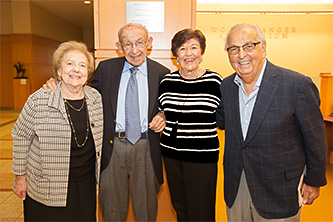 <p>Left to right: Connie Stopol, Philip Stopol '47, Irene Stein '47, and Howard Stein '47 are all smiles in front of the Stopol plaque in the Brooklyn College Library.</p>