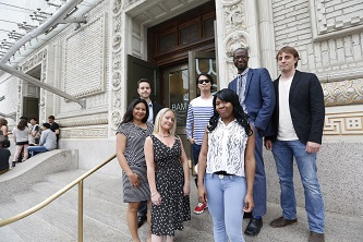 <p>The Faculty Select filmmakers stand outside of the Brooklyn Academy of Music (from left to right): Maritza Gomez '14, Acharya Partin '14, Jenny McQualie '14, Lee Jung Woo '14, Lorraine Singletary '14, Rashan Castro '14, and Sean Dwyer '14.</p>