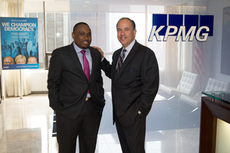 <p>At the KPMG offices in Midtown Manhattan, Anthony Castellanos '84 (right) congratulates Craig Henry '11 on his successful academic and career trajectory. </p>