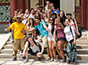 <p>Done (front and center) and his fellow students can barely contain their excitement as they visit Beijing's famed Forbidden City.</p>