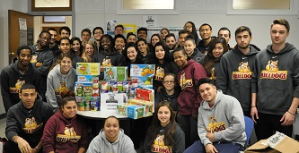 <p>Leaders of the pack: The Brooklyn College Bulldogs teamed up to collect more than half of the over 1,000 canned food items for the Thanksgiving drive. </p>