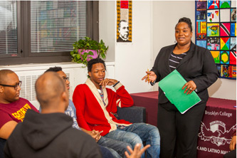 <p>Nicole St. Clair and some of the students enrolled in the Black and Latino Male Initiative.</p>