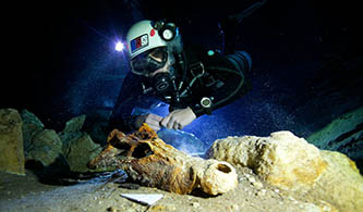 <p>A diver searches for fossils in Madagascar.</p>