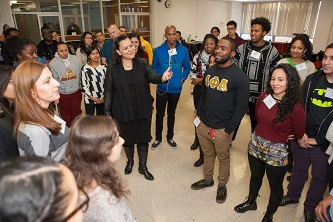 <p>The first of three Brooklyn College Rhodes Scholars, Lisette Nieves '92 (center) shares what she learned about leadership with students, including senior Mickael Dejean (in black sweatshirt to Nieves' left), at a special leadership workshop in the Student Center.</p>