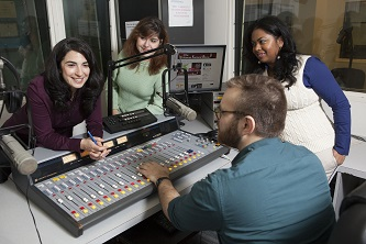 <p>Each time Forlano and her student interns produce <em>The Julianna Forlano Show</em>, (from Brooklyn College's very own radio station, WBCR), listeners nationwide can count on two things: political consciousness-raising and hilarity. (Clockwise from left: Forlano, Faina Cordover, Chantelle Teekasingh, and Charles Carr)</p>