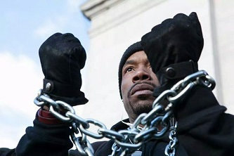 <p>At the Millions March in New York, Brooklyn Collegestudent K. LaMonte Jones wore chains around his neck and wrists to symbolize what he believes are the ways in which marginalized groups are treated by authorities.</p>