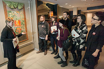 <p>Maria Ann Conelli, dean of the School of Visual, Media and Performing Arts, talks to the museum studies students during a class at the Rubin Museum of Art. </p>