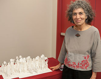 Art student Judith Rubin with her winning entry at the ceremony for the Labor Arts Awards.
