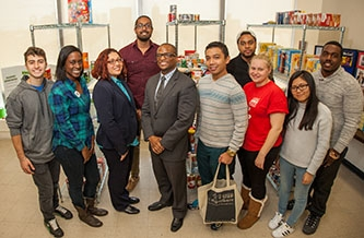 <p>Dean of Students Ronald C. Jackson with students at the Brooklyn College Food Pantry, located in the Student Services Center. </p>