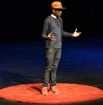 <p>Sean DesVignes recites his poetry at the TEDxCUNY conference.</p>
