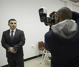 <p>Senior Isaak Boltyansky is ready for his closeup at the LinkedIn photo booth.</p>