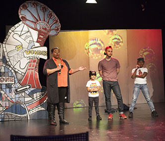 <p>Brooklyn's Best host J.J. Mattise introduces the third group of contestants in the program's premiere show. The trio of break dancers went on to win that night. </p>