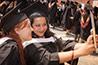 <p>New graduates take a moment for a joyous selfie.</p>
