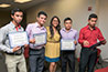 <p>College student from Puebla hold diplomas received after completing an English language and cultural immersion program at Brooklyn College. </p>