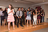 <p>Coordinator of Graduate Studies Beatrice Tony-Jean teaches college students the Electric Slide after the graduation ceremony held at Brooklyn College's 25 Broadway location in Lower Manhattan for students who completed the English language and cultural immersion program.</p>