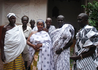 <p>Professor Lynda Day, center, with her Ghanaian hosts</p>