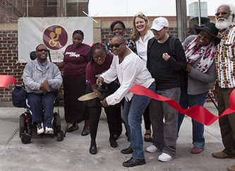 <p>Members of S.O.F.E.D.U.P. and the disabled community celebrate the opening of the new Bedford Avenue Access-a-Ride shelter with President Michelle Anderson.</p>
