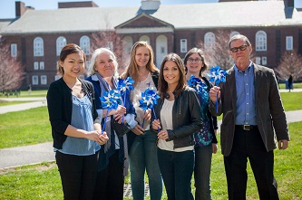 <p>The Brooklyn College community gathers in support of child abuse prevention. Left to right: student Jasmine Lee; Christine Pawelski Ed.D.; students Elizabeth Koennicke, Jennie Guzman, and Amelia Blackwood;<span style=