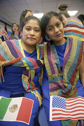 <p>High school seniors Valeria Ram&iacute;rez Ju&aacute;rez (L) from Tlacamilco Acajete, who aspires to study physics and bio-medicine, waits for her diploma with her new 'bestie' Andrea Garc&iacute;a Tepale, who hails from the town of Juan C. Bonilla and plans to study marketing.</p>
