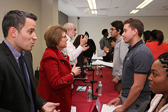 <p>From left: Raphael Miranda '06, Marge Magner '69, and Daniel Greenberg '66 answer student questions.</p>