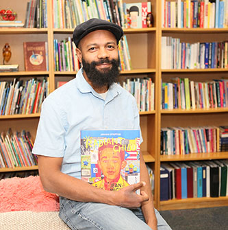 <p>Javaka Steptoe with his latest book about Jean-Michel Basquiat. </p>