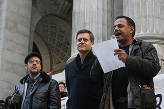 <p>Professor Moustafa Bayoumi reads at the PEN America Writers Resist rally with (from left) artist-activist Charlie V&aacute;squez and New York State Senator Brad Hoylman. &copy; Terrence Jennings&nbsp;</p>