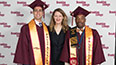 <p>President Michelle J. Anderson congratulates the 2017 valedictorian, Kevin LaMonte Jones (right), and salutatorian, Michael A. Franco (left).</p>