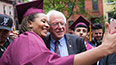 <p>Lucky graduates get their selfies with Bernie Sanders.</p>