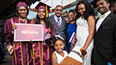 <p>An extended Brooklyn College family congratulates their graduate.</p>
