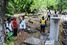 <p>The Chief of the Charlestown Maroon Community shows the BLMI group the cemetery where the Maroon ancestors are buried.</p>