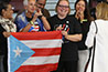 <p>A group of Puerto Rican women display the island's flag with pride to welcome Mayor Cruz Soto.</p>