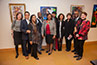 <p>Professor Jean-Eddy Saint Paul (second from right) and Maria Ann Conelli, dean of School of Visual, Media and Performing Arts, (far right), with the artists at the opening of 'The Universal Dimension of Haitian Culture: History and Politics of Memory' at the Brooklyn College Library. Miriam B. Deutch, associate professor/associate librarian for research and access services is at far left.</p>