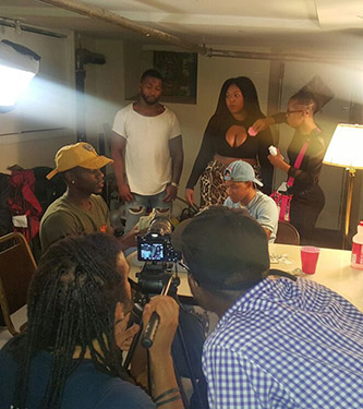 <p>Ashley (black hat) and the cast of <em>The Ave</em> on set.</p>