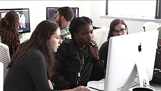 <p>Students (from left to right) Angelica Goldberg, S&eacute;un Olukanni, and Sara Schwartz edit their video for the Diversity and Media Access Summer program.</p>