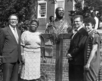 <p>From L to R: Then college President Robert L. Hess, then head of the Black Alumni Association Marcia Goldman '57, sculptor Bo Walker, and his wife Barbara Walker.</p>