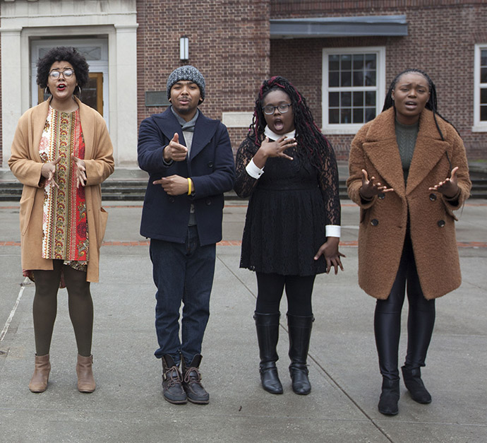 <p>Four members of the Brooklyn College Slam Poetry Team perform their poems simultaneously in front of the Brooklyn College Library. Left to right: Jenna Carter-Johnson, Jared Green, Khadjiah Johnson, and Sor&eacute; Agbaje. Photo by David Rozenblyum.</p>