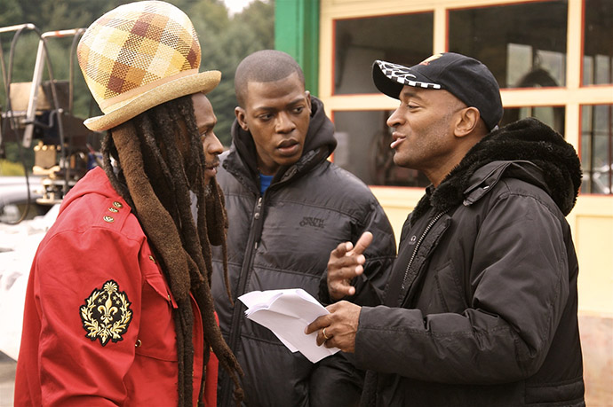 <p>On the set of his award-winning documentary <em>Rocksteady</em>, Khan (right) talks with reggae legend David Hinds of the critically acclaimed band Steel Pulse.</p>