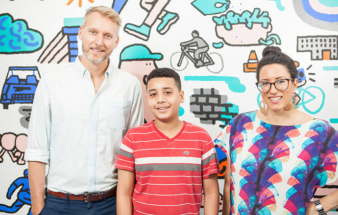 <p>Burgess, Mamoud Ali, and Nuzzo are all smiles in front of the mural that exemplifies joint effort. Photo by Craig Stokle.</p>