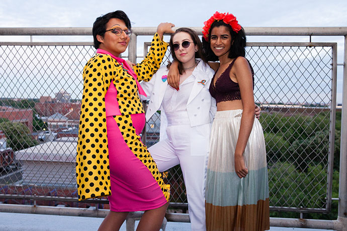 Daniel Vázquez Sanabria, left, with his two friends Nerea Blanco, (center) and Dena Bhagalia on the rooftop of the Student Center for the queer prom.
