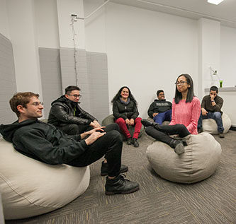 <p>Students test out the bean bags in the new Room for Quiet Reflection. </p>