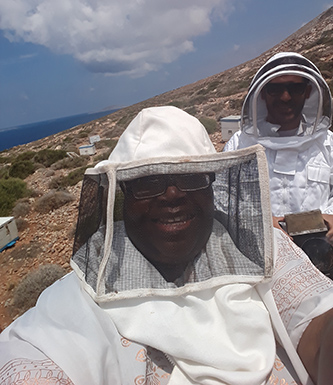 Senior Deborah Alves with the bees in Greece for her Rosen project.