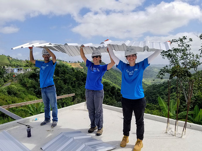 Nischal Giri, far left, working on a roof in Puerto Rico with his CUNY crew. Photo courtesy of Nischal Giri
