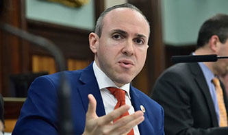 Mark Treyger, was one of the most persistent voices in the debate over whether to close the public schools. Treyger, who majored in political science as an undergraduate and received master's degrees in social studies education and school leadership, was adamant that shutting down the K–12 system was necessary in order to flatten the curve of the pandemic. Eventually, most of his proposals—to close the schools for instruction while leaving a few buildings open in each district to provide essential services like meals—were adopted when Mayor Bill de Blasio announced school closures in mid-March.  Treyger went on to advocate for all meal-access sites, which are mostly housed in the schools, to serve kosher and halal meals, and for the city's Department of Education to release the number of employees who died from COVID-19.