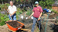 <p>Don Quigley, a neighborhood resident, and Victoria Gagliano, former BC gardener, working in the garden.</p>