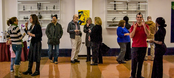 Professors and students mingle at the Student Center's Art Gallery.