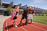 Training on the athletic field with President Anderson and Buster.